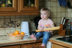 Little girl playing in the kitchen Stock Photography