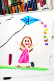 Little girl playing with a kite Royalty Free Stock Images