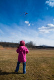 Girl playing with a kite Stock Image