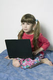 little girl playing on laptop Royalty Free Stock Images