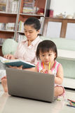 LIttle girl playing laptop Stock Photography