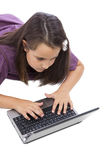 Little girl playing with a laptop Royalty Free Stock Image