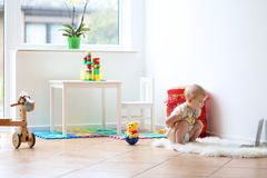Little girl playing with laptop on the floor Royalty Free Stock Images