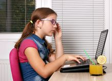 Little girl playing laptop Royalty Free Stock Photos