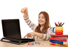 Little girl playing laptop Stock Photo