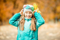 Little girl playing with leaves Stock Photos