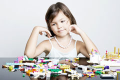 Little girl playing in lego blocks Royalty Free Stock Photos