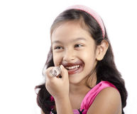 A little girl playing with a lipstick Royalty Free Stock Photography