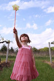 Little girl playing with magic wand Stock Photo