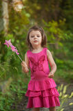 Little girl playing with magic wand Royalty Free Stock Photos