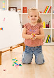 Little girl playing with magnetic board. Numbers and letters Stock Image