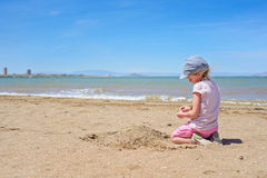 Little girl playing on the Mar Menor beach Royalty Free Stock Photos
