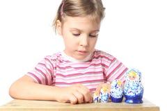 Little girl playing with matryoshka isolated Stock Photography