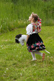 Little girl playing on a meadow Stock Photos