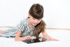 Little girl playing with apple ipad tablet