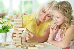 Little girl playing with mother royalty free stock photos