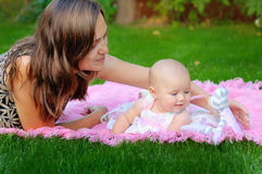 Little girl playing with mother in the park Royalty Free Stock Photography