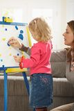 Little girl playing with mum Stock Photo