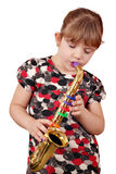 Little girl playing music Stock Image