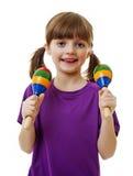 Little girl playing music Stock Photo