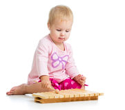 Little girl playing with musical toy Royalty Free Stock Photo