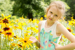 Little girl playing in nature Stock Photo