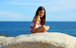 Little girl playing at ocean front in  Los Cabos Mexico resort cliff sea. Little girl playing at the pool in Mexican villa pool party 50 megapixels photo Stock Image