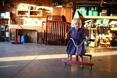 Free Little Girl Playing On Ride On Scooter In Garage Royalty Free Stock Photos - 101151548