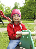 Little girl playing outdoor Stock Photos