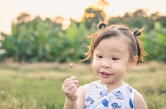 Little girl playing outdoor Stock Image