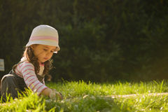Little girl playing outdoor Royalty Free Stock Photo
