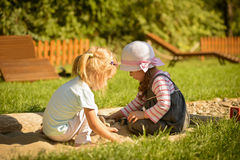 Little girl playing outdoor. Stock Images