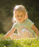 Little girl playing outdoor. Royalty Free Stock Photos