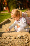 Little girl playing outdoor. Royalty Free Stock Photo