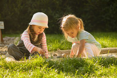Little girl playing outdoor. Royalty Free Stock Image