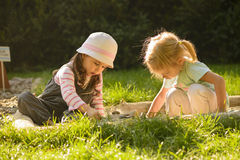 Little girl playing outdoor. Stock Photography