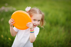 Little girl playing outdoors Royalty Free Stock Photography