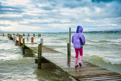 Little girl playing outdoors Royalty Free Stock Image