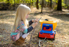 Little girl playing outdoors in the garden Royalty Free Stock Image