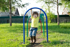 Little girl playing outdoors. Kid on playground,children activity. Child having fun. Active healthy childhood Stock Photos
