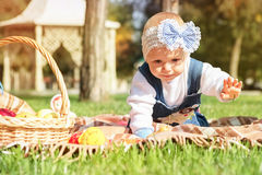 Little girl playing outdoors in the park. Royalty Free Stock Image
