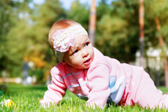 Little girl playing outdoors in the park. Royalty Free Stock Images