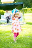 Little girl playing outdoors in summer Stock Photography
