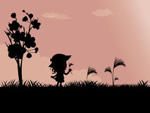 A little girl playing outside. Silhouettes of Child playing outside Royalty Free Stock Photography