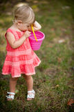 Little girl playing with pail. In park royalty free stock image