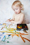 Little girl playing with paint colors Stock Photo