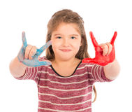 Little Girl Playing with Paint doing the horns. Royalty Free Stock Photos