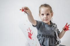 Little Girl Playing With Paint Stock Images