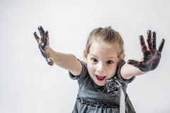 Little Girl Playing With Paint Stock Photo