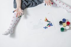 Little Girl Playing With Paint Stock Image
